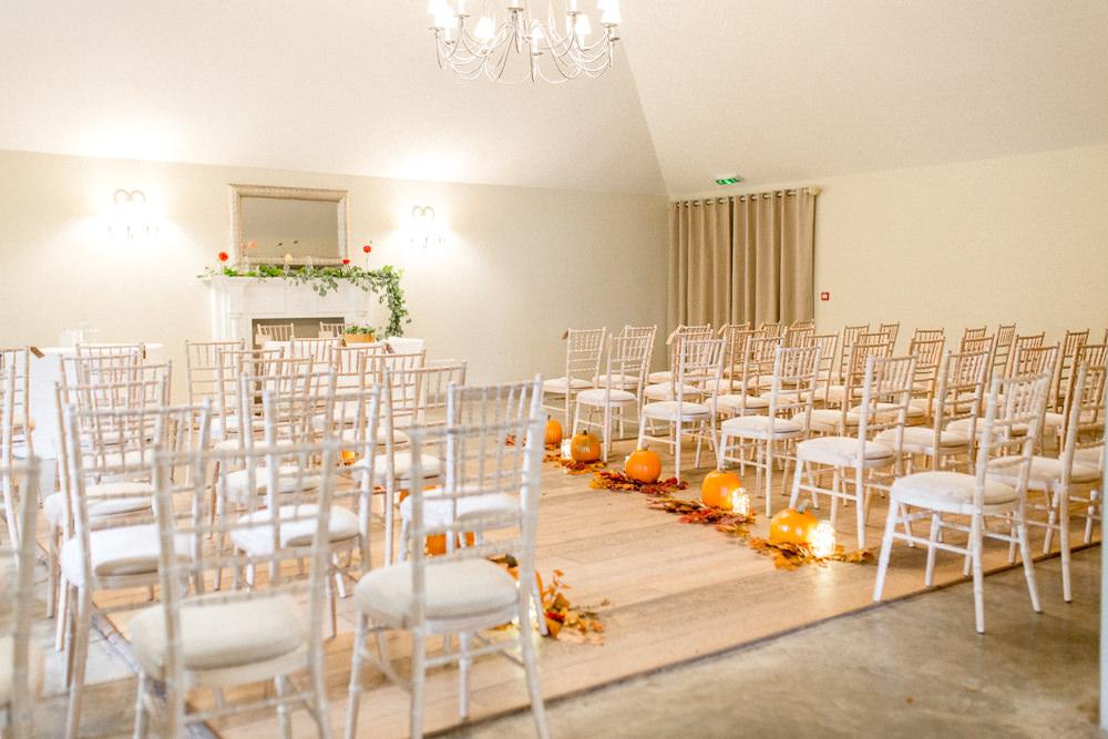 Ceremony Aisle Pumpkins Candles Leaves Autumnal Boho Wedding Ivory White Photography