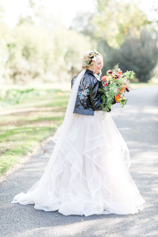 Dress Gown Bride Bridal Lace Strapless Sweetheart Stella York Princess Ruffle Skirt Leather Jacket Autumnal Boho Wedding Ivory White Photography