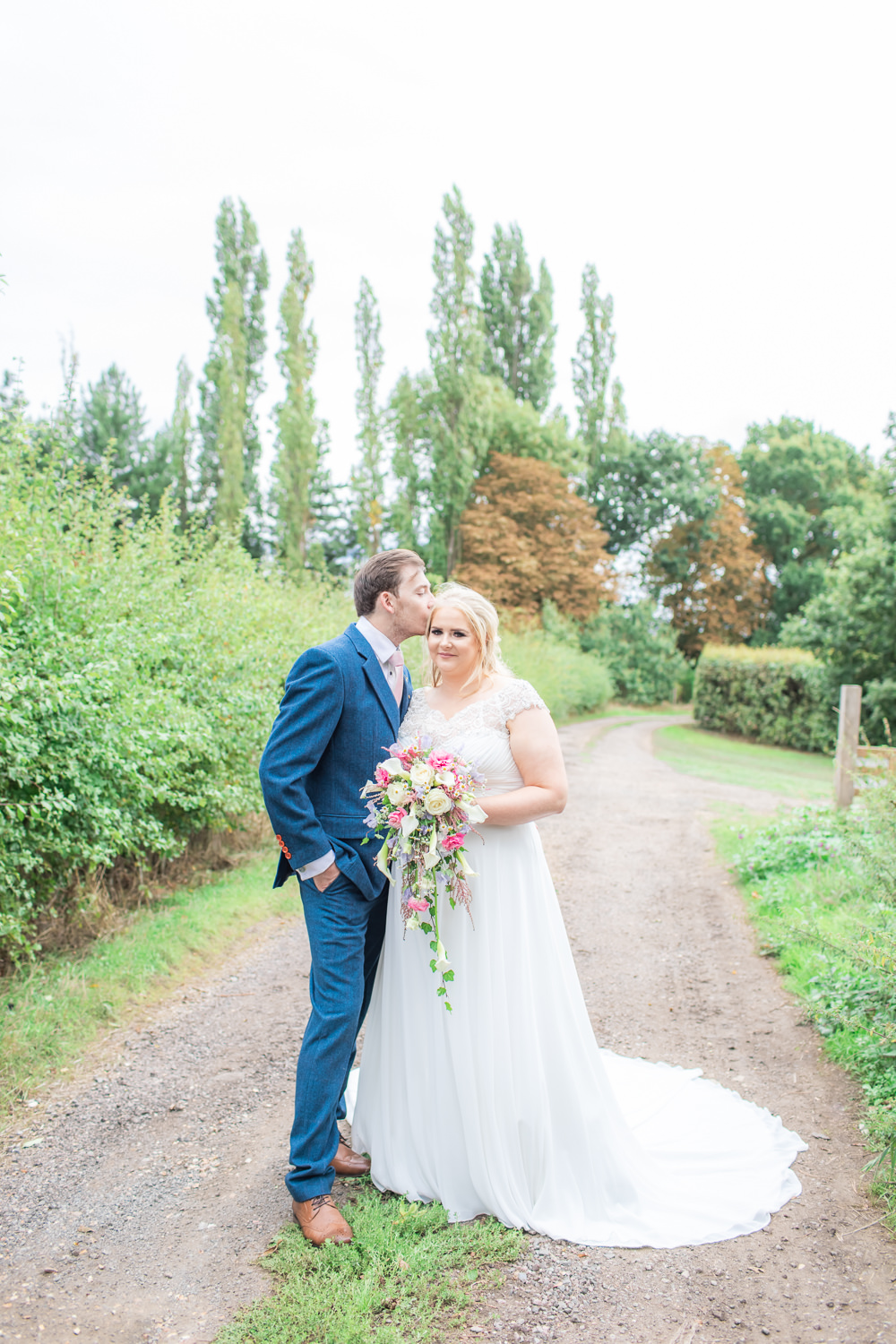 Bride Bridal Short Sleeve Lace V Neck Dress Gown Navy Wool Tweed Suit Groom Waterfall Bouquet Bedfordshire Tipi Wedding Natalie Stevenson Photography