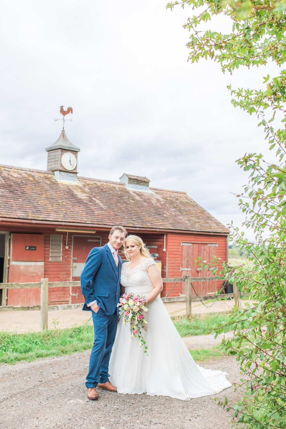 Bride Bridal Short Sleeve Lace V Neck Dress Gown Navy Wool Tweed Suit Groom Waterfall Cascading Bouquet Bedfordshire Tipi Wedding Natalie Stevenson Photography
