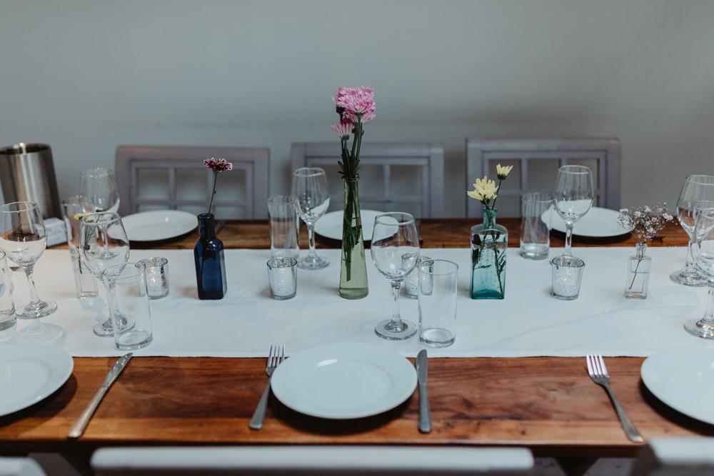 Simple Wooden Table Decor Flowers Bottles Chilli Barn Wedding Stevie Jay Photography
