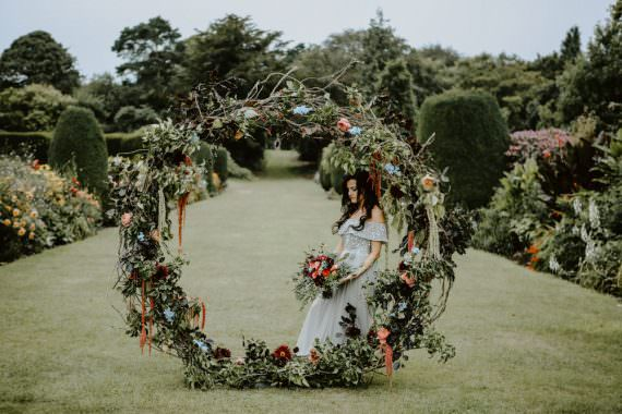 Flowers Moongate Arch Backdrop Greenery Foliage Rose Red Orange Cosmos Dahlias Oxypetalum Ethereal Romantic Wedding Ideas Katherine Newman Photography