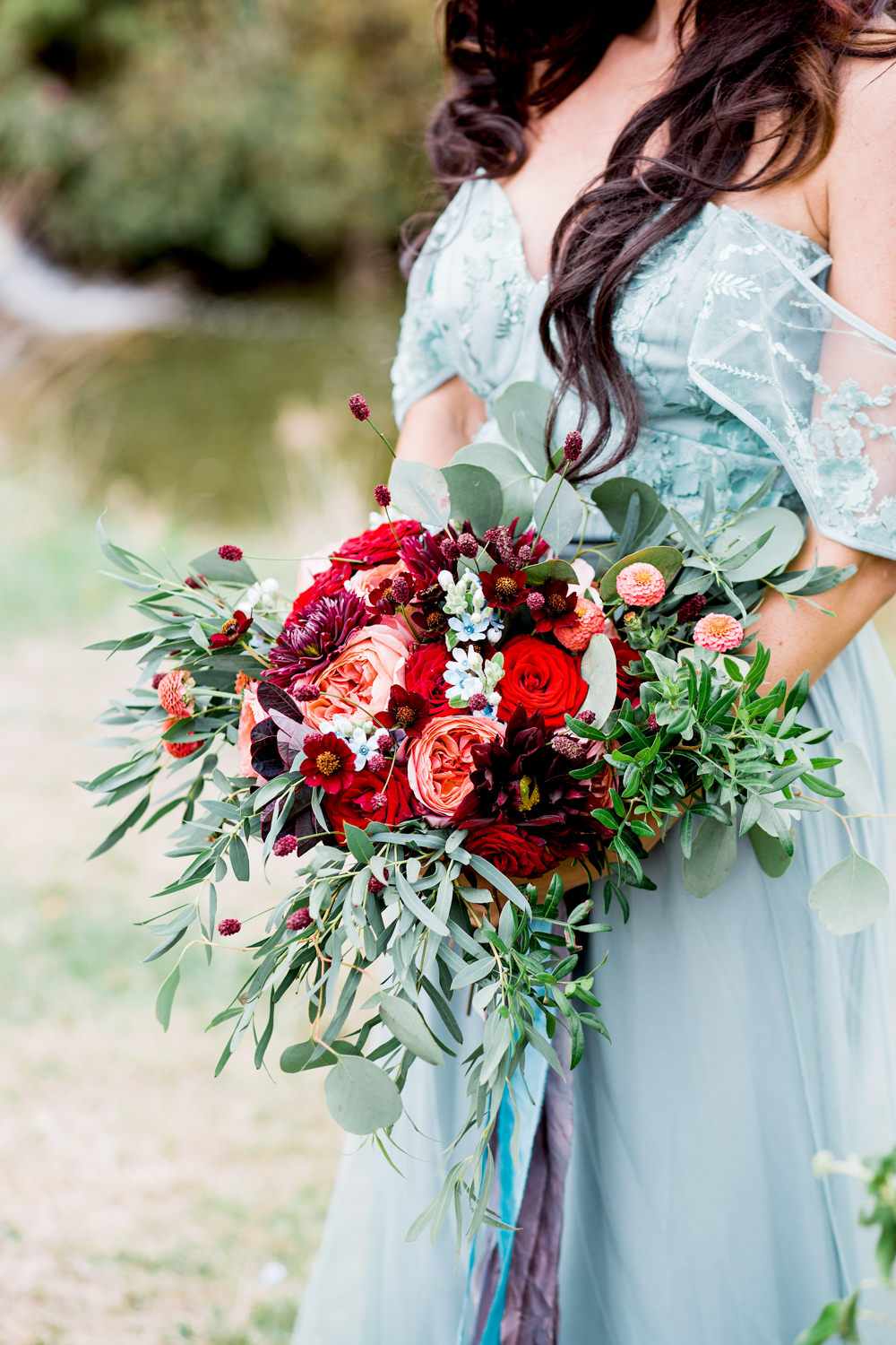 Bouquet Flowers Bride Bridal Greenery Foliage Rose Red Orange Cosmos Dahlias Oxypetalum Ribbons Ethereal Romantic Wedding Ideas Katherine Newman Photography