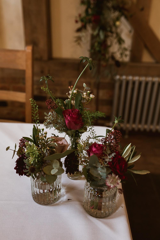 Bottle Jar Flowers Greenery Foliage Red Burgundy Rose Gate Street Barn Wedding The Springles