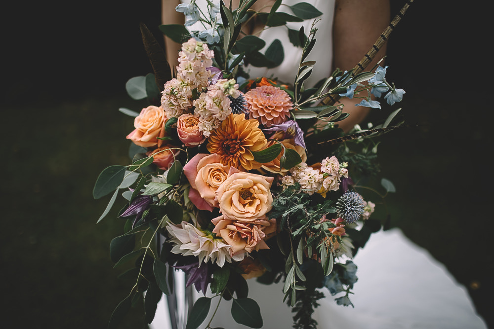 Bouquet Flowers Bride Bridal Coral Peach Rose Dahlia Thistle Greenery Feather Gilbert Whites House Barn Wedding Carrie Lavers Photography