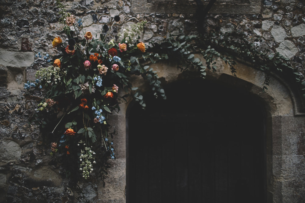 Arch Flowers Door Way Coral Peach Rose Dahlia Thistle Greenery Gilbert Whites House Barn Wedding Carrie Lavers Photography
