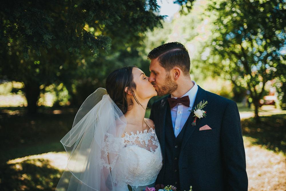 Bride Bridal Dress Gown Sweetheart Bolero Off Shoulder Lace Navy Suit Groom Burgundy Oxblood Bow Tie Veil Kittisford Barton Wedding Joab Smith Photography