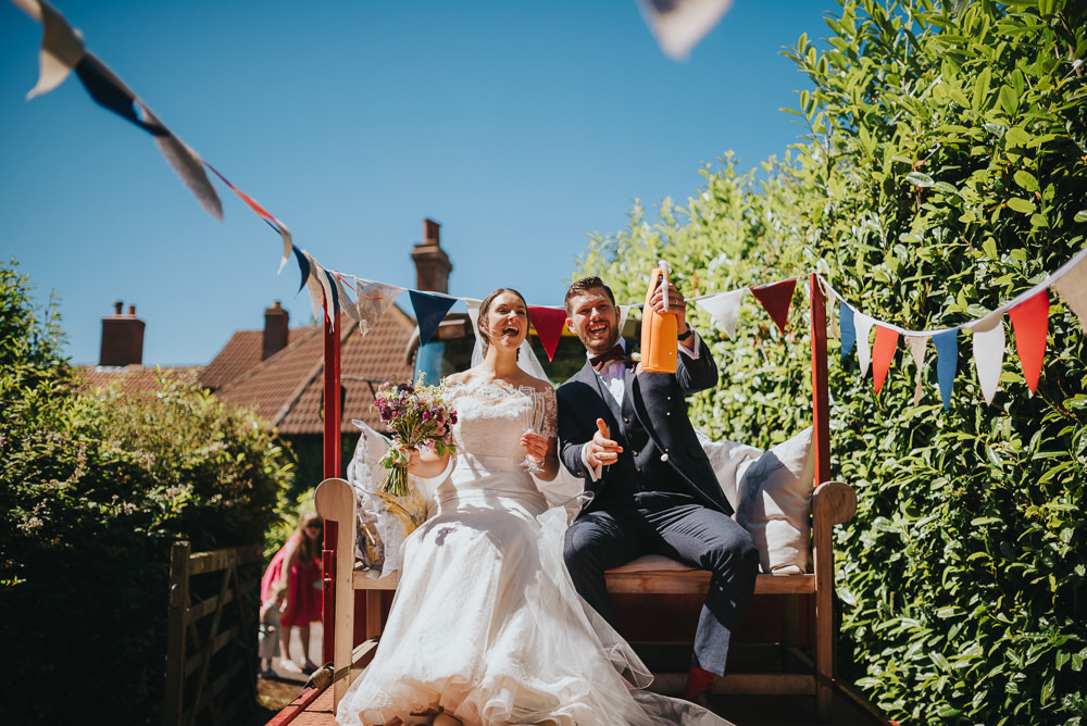 Bride Bridal Dress Gown Sweetheart Bolero Off Shoulder Lace Navy Suit Groom Burgundy Oxblood Bow Tie Tractor Bunting Kittisford Barton Wedding Joab Smith Photography