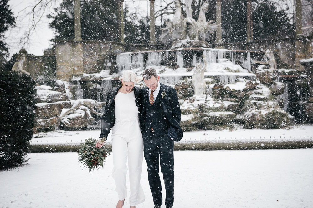 Bride Bridal House of Ollichon Jumpsuit Trousers Lace Sleeves Back Greenery Foliage Bouquet Flowers Leather Jacket Orleans House Gallery Wedding My Beautiful Bride Photography