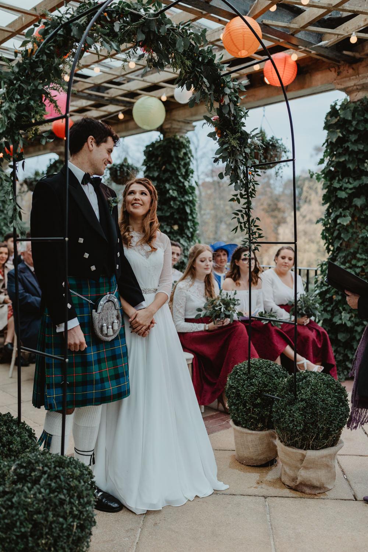 Bride Bridal Sweetheart Neckline Dress Gown Three Quarter Sleeve Cover Up Hair Vine Kilt Groom Flower Arch Sun Pavilion Wedding Stevie Jay Photography