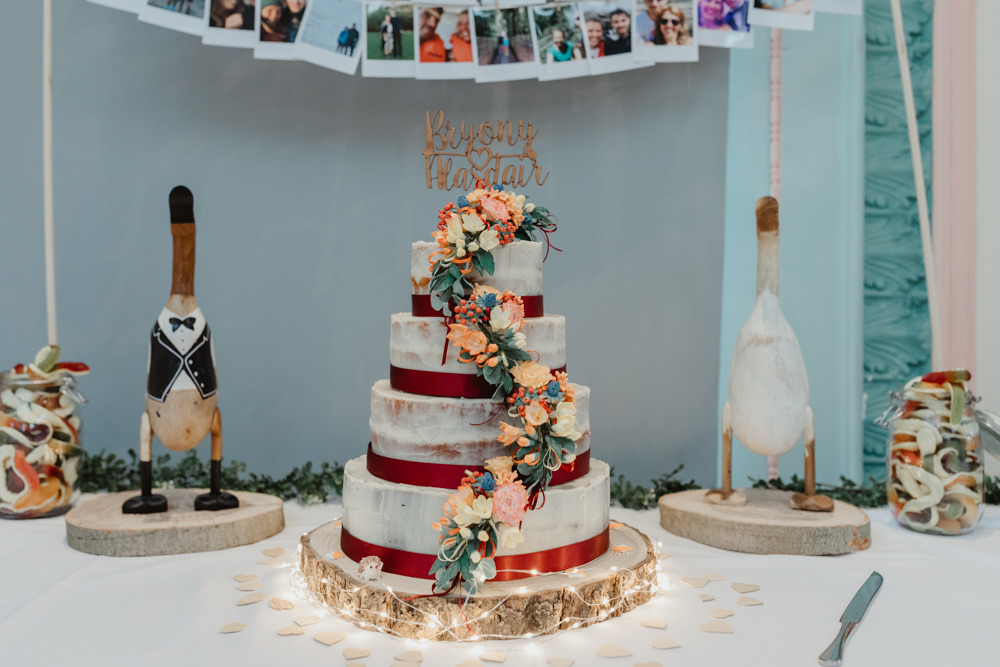 Semi Naked Cake Ribbon Wood Slice Sugar Flowers Wooden Duck Sun Pavilion Wedding Stevie Jay Photography