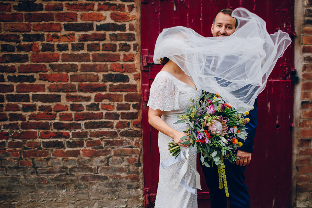 Bride Bridal V Neck Sleeves Beaded Detail Dress Gown Blue Suit Groom Veil Tropical Bouquet Tatton Wedding Stock Farm Barn Amy B Photography