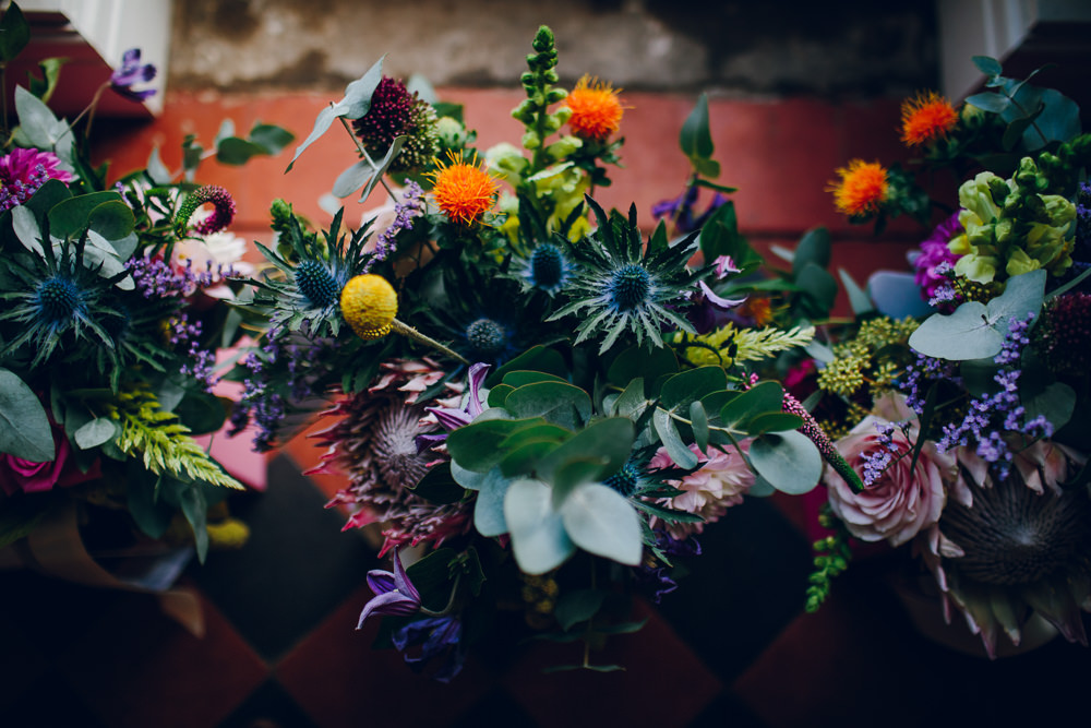 Multicoloured Flowers Sea Holly Orange Eucalyptus Tatton Wedding Stock Farm Barn Amy B Photography