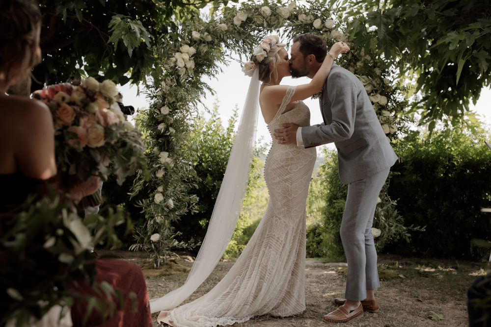 Ceremony Outdoors Backdrop Flowers Arch Floral Greenery Foliage Tuscany Destination Wedding ZONZO