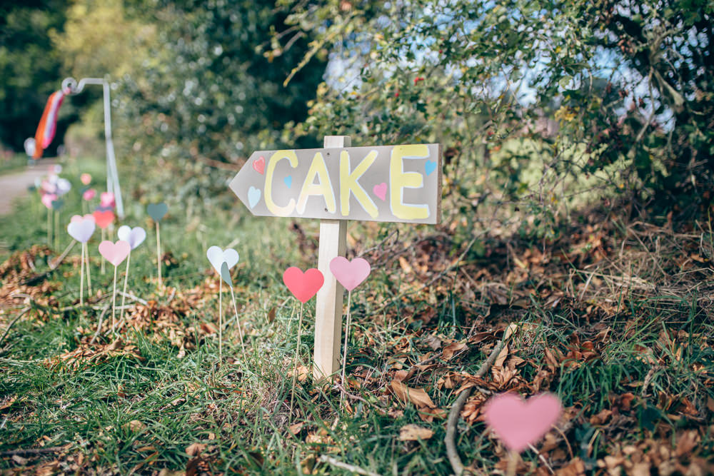 Painted Wooden Sign Post Signage Hearts Sticks Village Hall Wedding Samantha Kay Photography