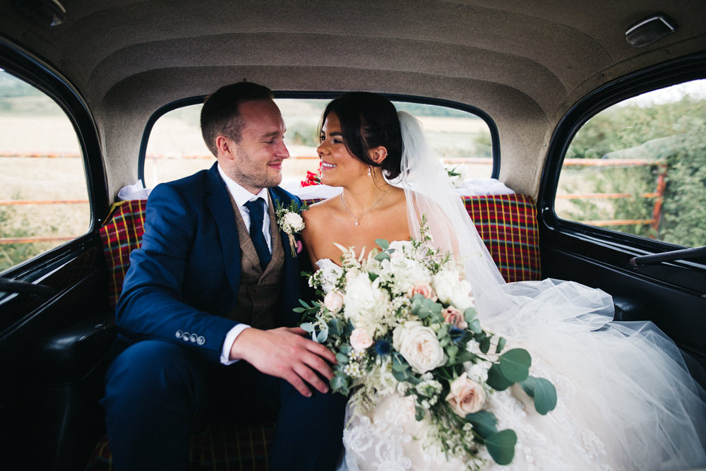 Bride Bridal Sweetheart Neckline Dress Gown Fit Flare Navy Suit Groom Tweed Waistcoat Veil Trailing Bouquet Whinstone View Wedding Sally T Photography