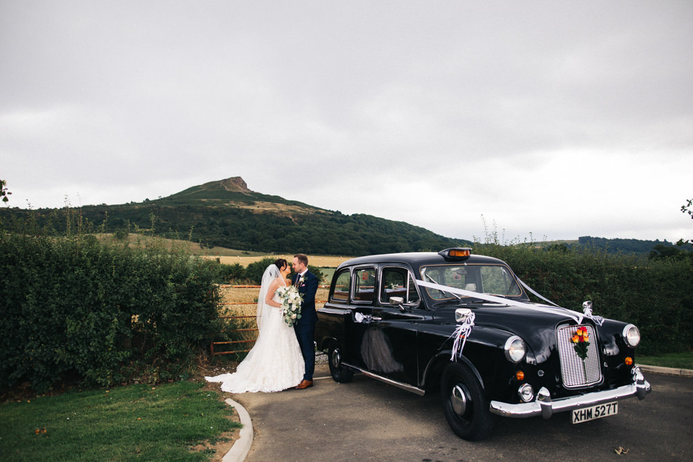 Black Cab Taxi Transport Bride Bridal Sweetheart Neckline Dress Gown Fit Flare Navy Suit Groom Tweed Waistcoat Veil Whinstone View Wedding Sally T Photography