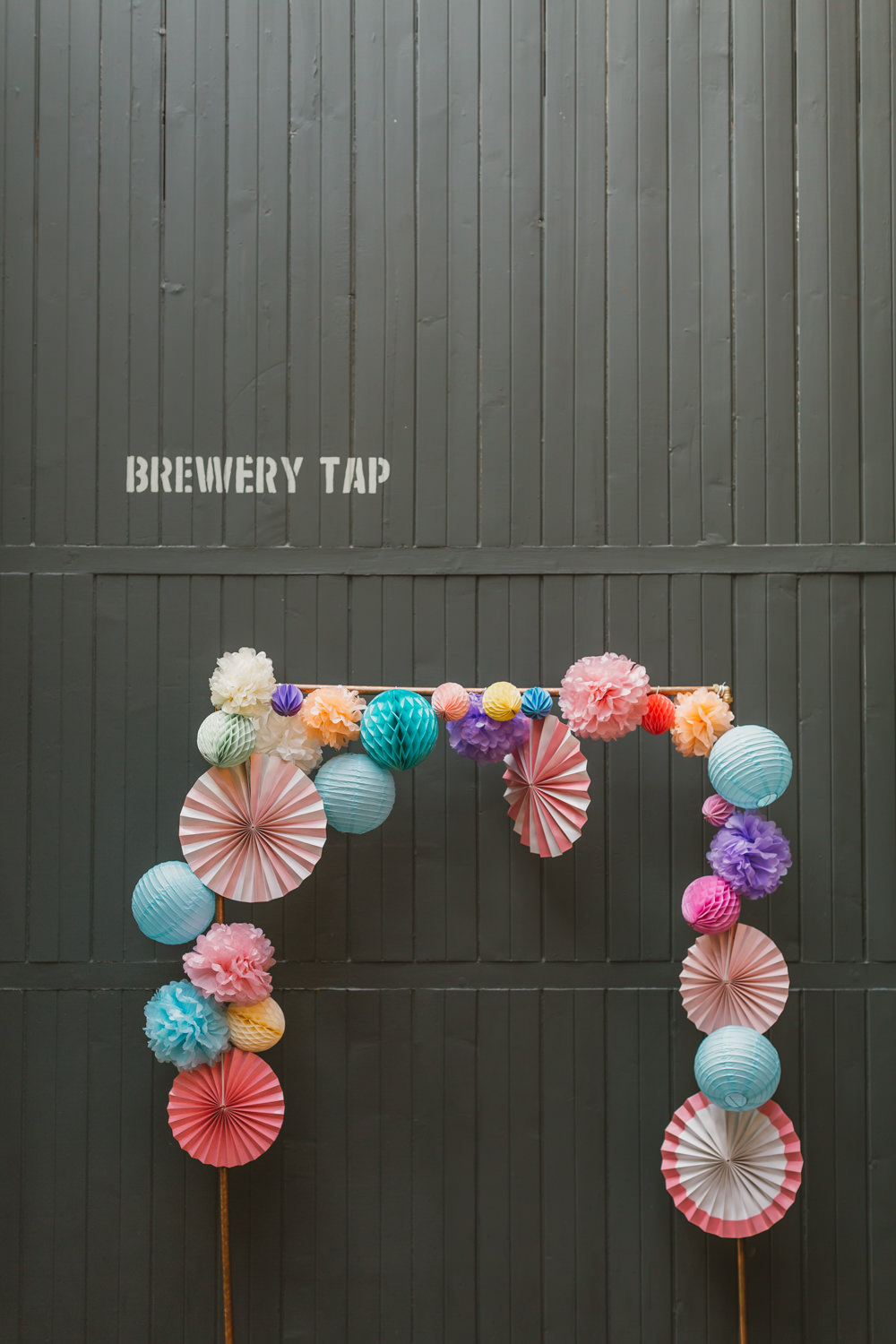 Backdrop Arch Photobooth Colourful Pom Poms Pinwheels Wylam Brewery Wedding Amy Lou Photography