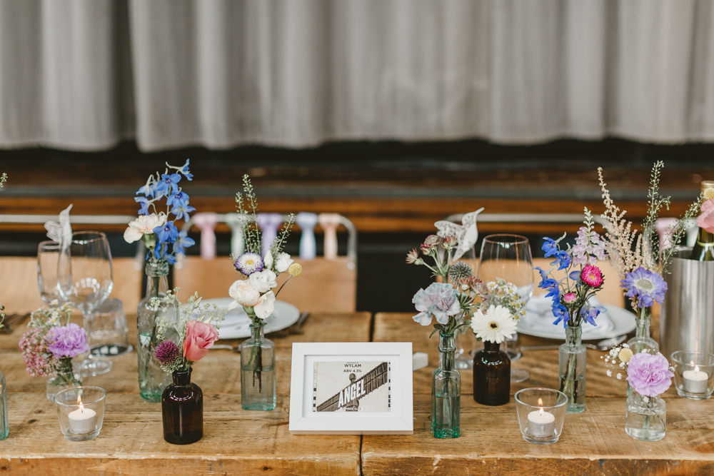 Table Flowers Decor Bottles Colourful Wildflowers Pretty Wylam Brewery Wedding Amy Lou Photography