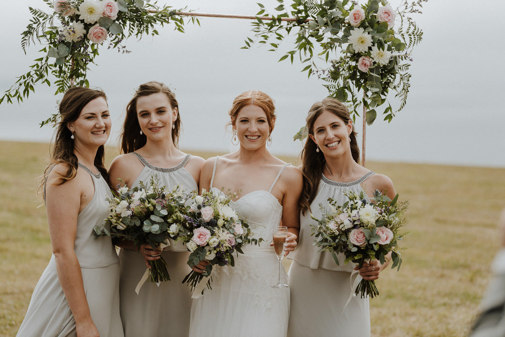Arch Backdrop Flowers Floral Greenery Bridesmaids Bre Pen Farm Wedding Nick Walker Photography