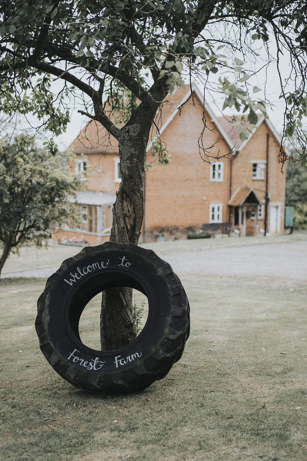 Welcome Sign Tractor Wheel Modern Calligraphy Celestial Cow Shed Wedding Tora Baker Photography