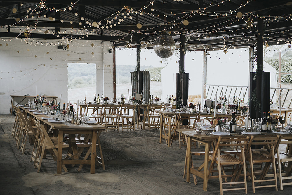 Feasting Table Festoon Lighting Disco Ball Barn Celestial Cow Shed Wedding Tora Baker Photography