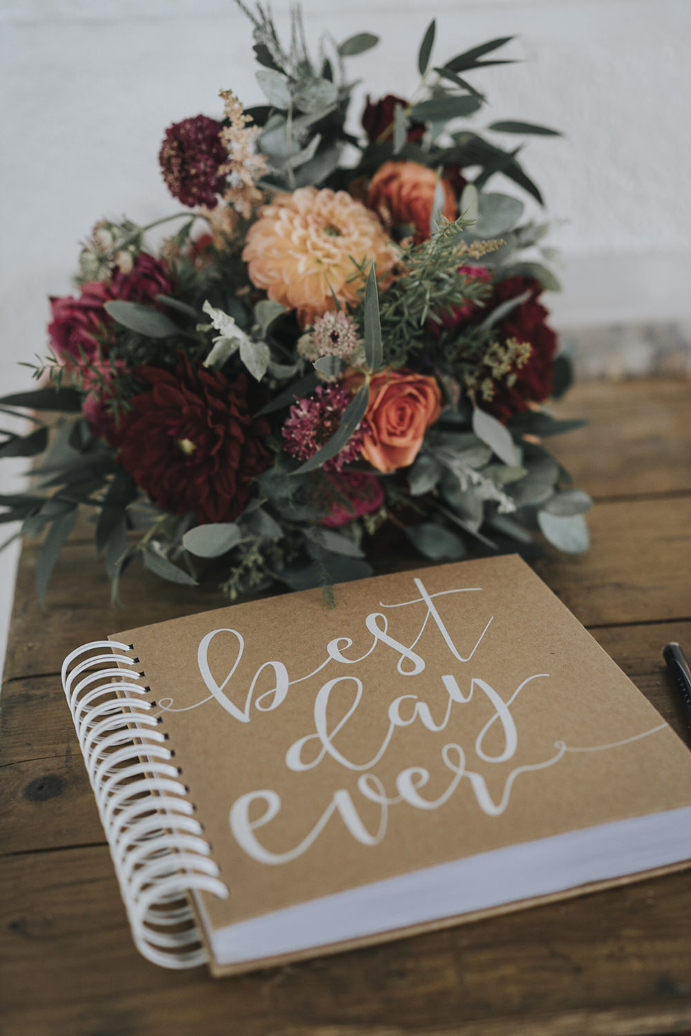 Bride Bridal Bouquet Dahlia Burgundy Coral Rose Eucalyptus Celestial Cow Shed Wedding Tora Baker Photography