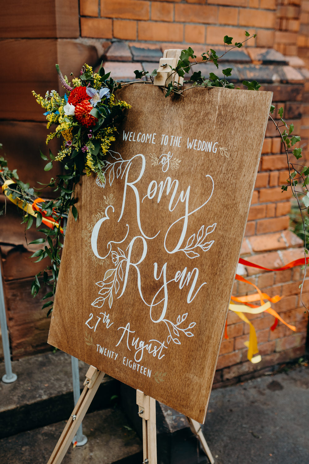 Wooden Welcome Sign Calligraphy Flowers Colourful Stretch Tent Wedding Peter Mackey Photography