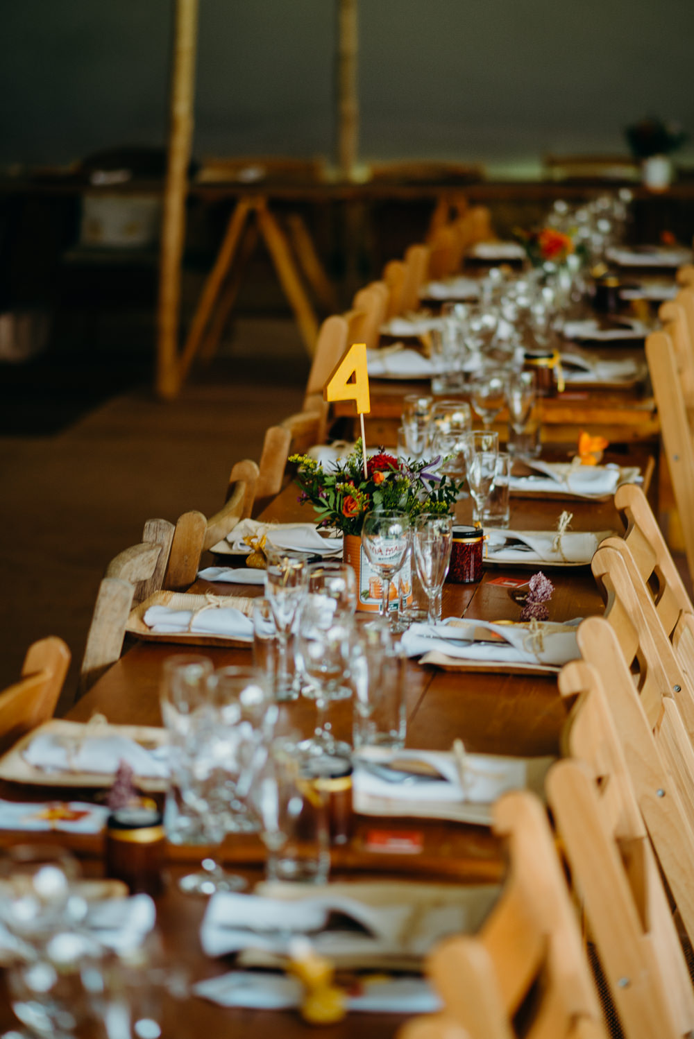 Long Wooden Trestle Tables Decor Colourful Stretch Tent Wedding Peter Mackey Photography