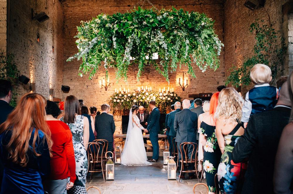 Greenery Foliage Hoop Chandelier Lanterns Aisle Ceremony Cripps Barn Wedding Isobel Murphy Photography