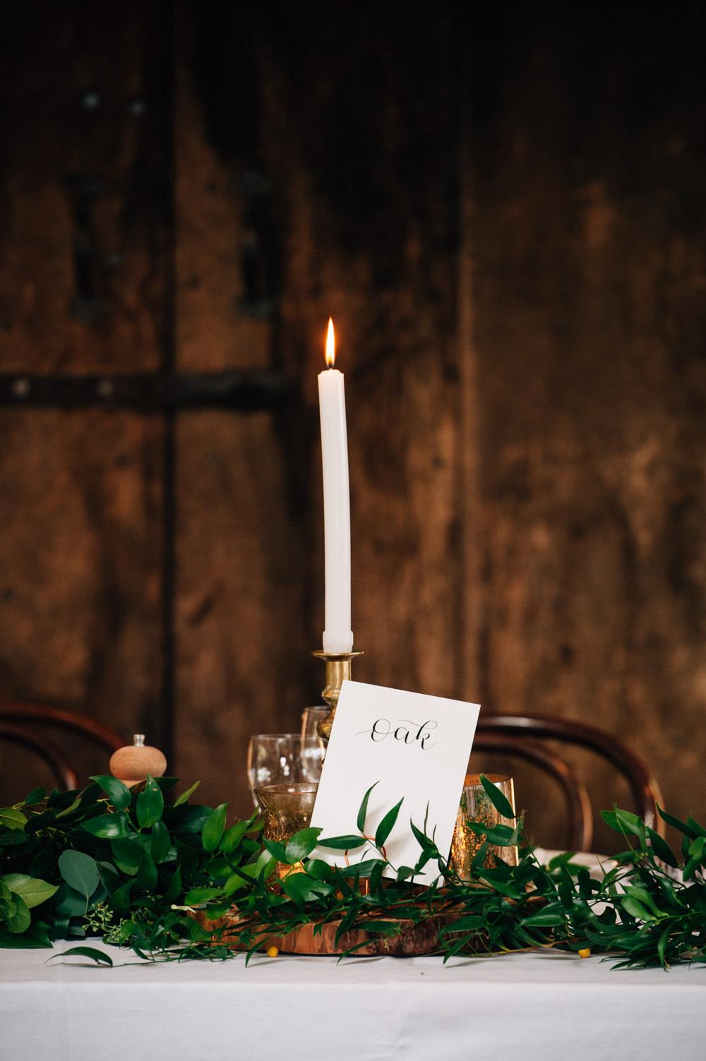 Calligraphy Table Name Candle Greenery Foliage Table Flowers Decor Cripps Barn Wedding Isobel Murphy Photography