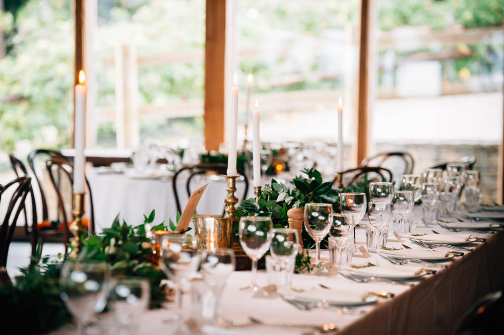 Candle Greenery Foliage Table Flowers Decor Cripps Barn Wedding Isobel Murphy Photography