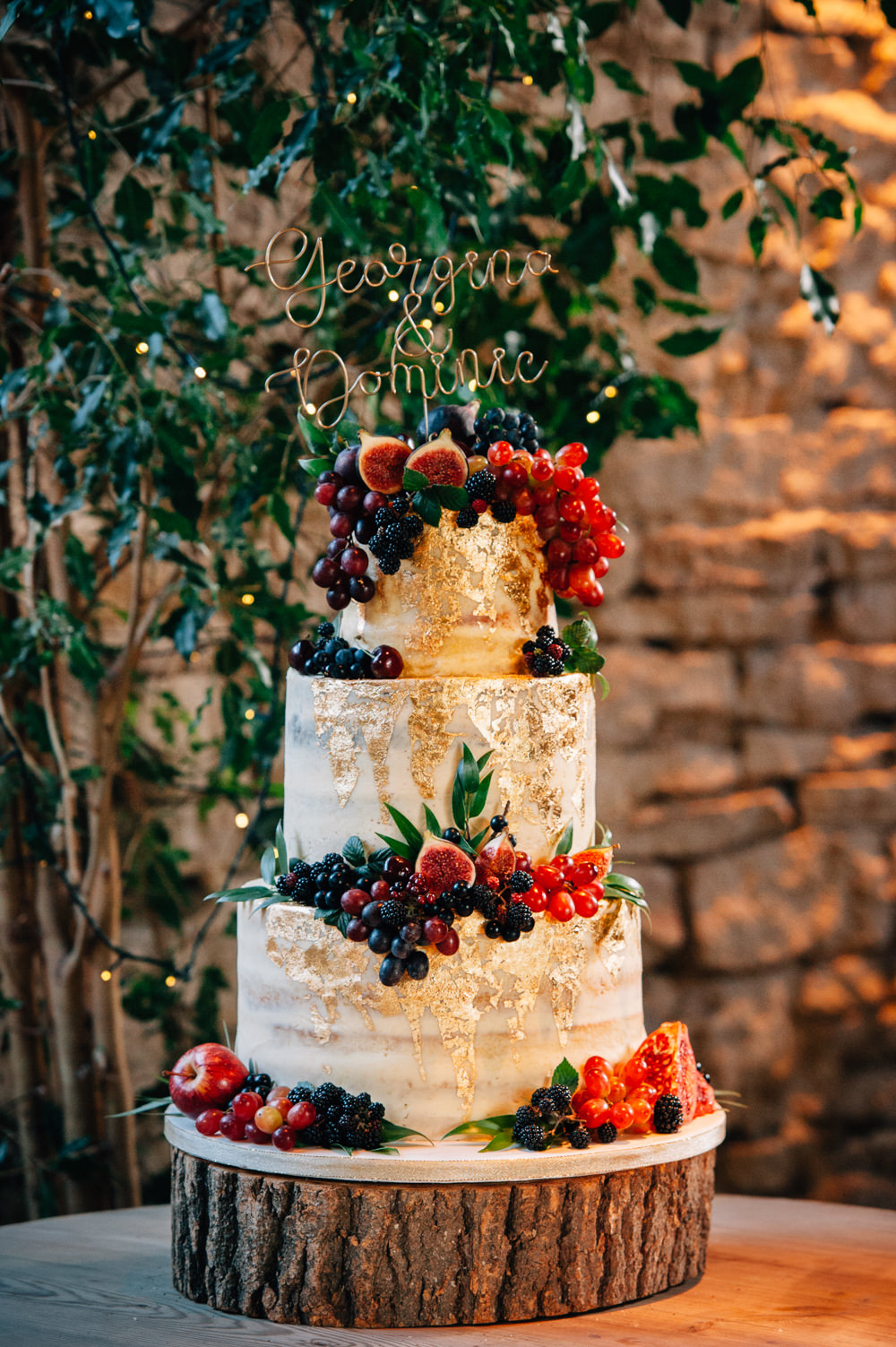 Semi Naked Cake Gold Leaf Berries Log Stand Wire Topper Cripps Barn Wedding Isobel Murphy Photography