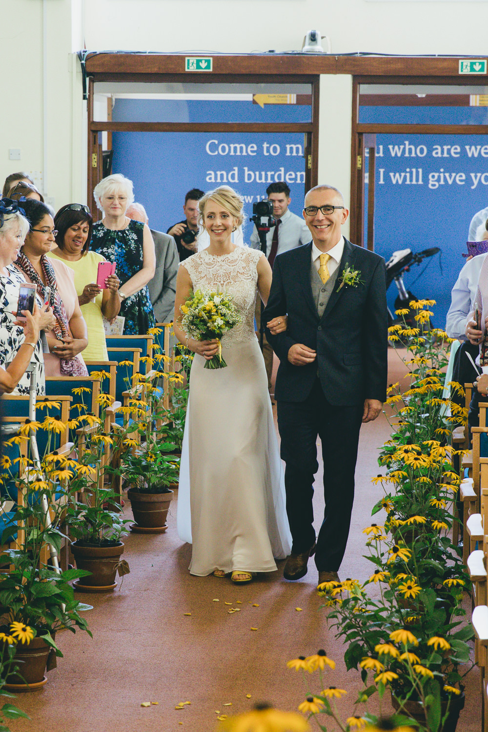 Bunting Yellow Flowers Aisle Ceremony Damerham Village Hall Wedding Lisa-Marie Halliday Photography