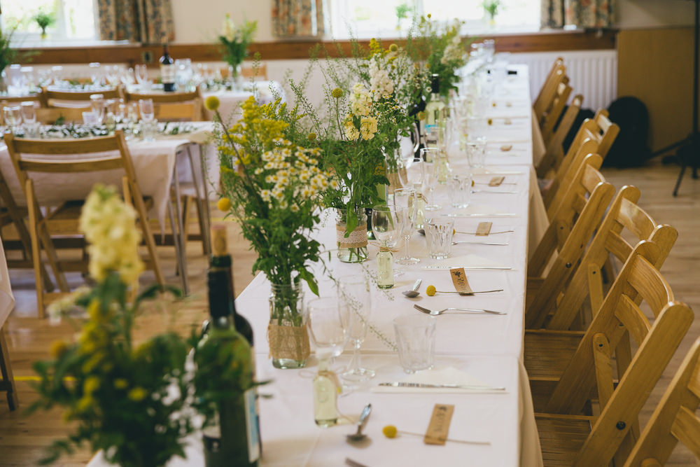 Long Tables Yellow Flowers Bottles Hessian Burlap Damerham Village Hall Wedding Lisa-Marie Halliday Photography