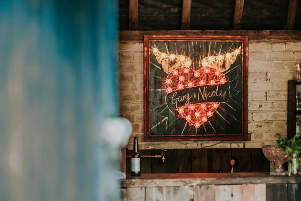 Light Bulb Sign Wing Heart Edwardian Inspired Wedding Daniel Ackerley Photography