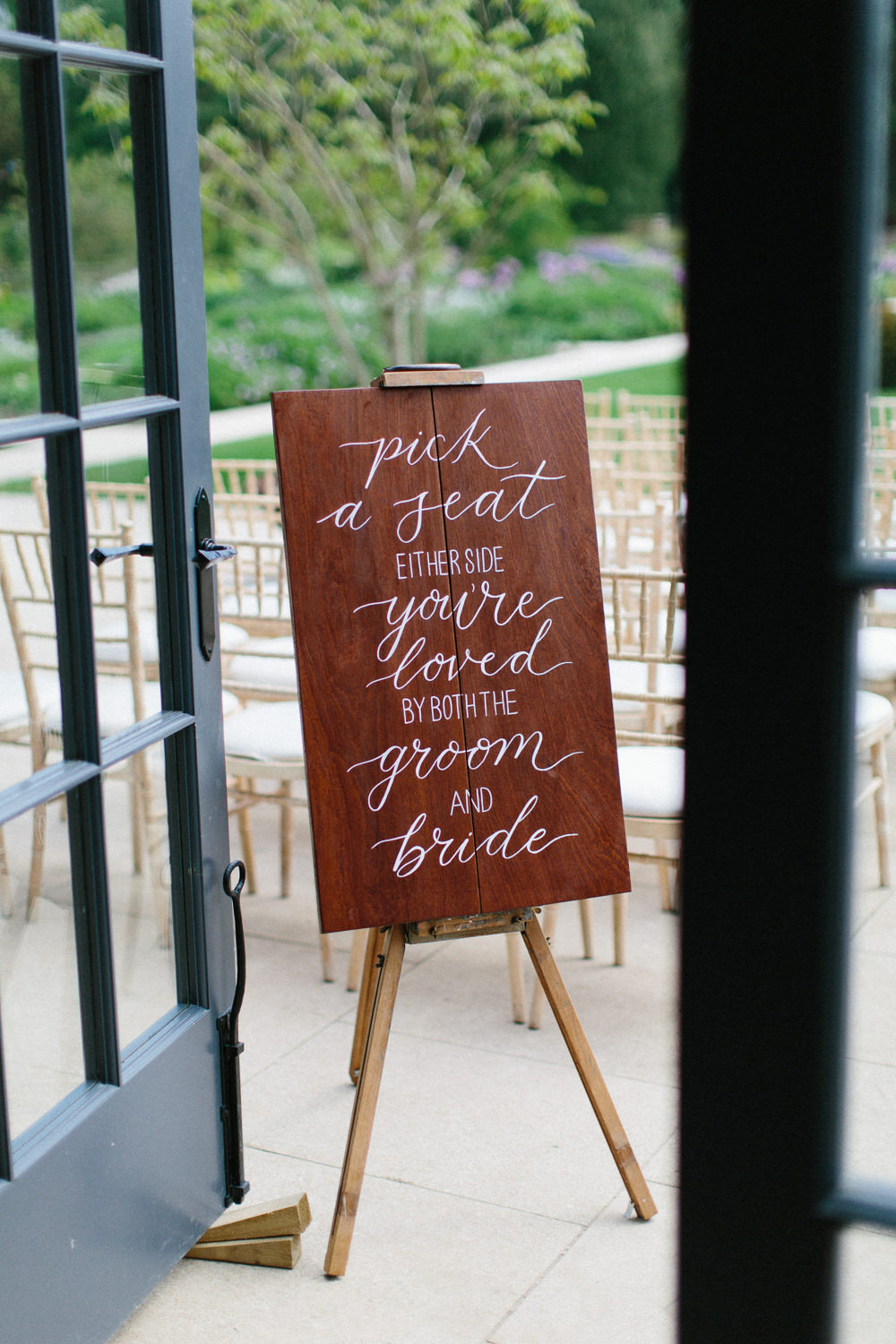 Wooden Modern Calligraphy Sign Pick A Seat Not A Side Garden Ceremony Wedding Melissa Beattie Photography