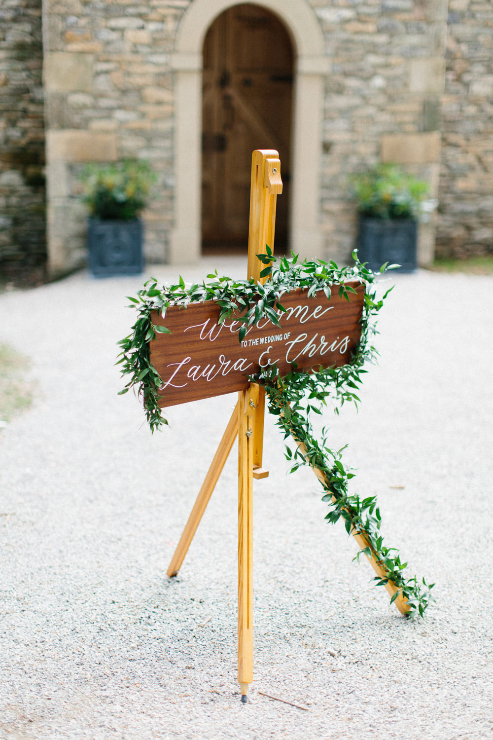 Welcome Sign Wooden Calligraphy Greenery Foliage Easel Garden Ceremony Wedding Melissa Beattie Photography