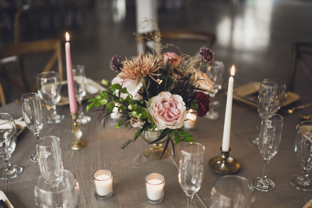 Table Decor Tablescape Flowers Pink Grey Flowers Centrepiece Candles Kindred Barn Wedding The Kindred Collective