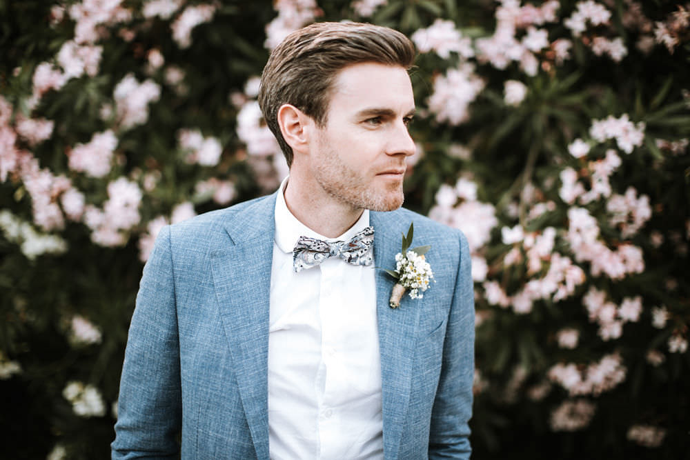 Blue Suit Groom Floral Bow Tie Portugal Destination Wedding Ana Parker Photography