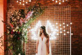 Flower Installation Backdrop Neon Sign Greenery Foliage Metal Romantic Wedding Ideas Neon Lighting Kate McCarthy Photography