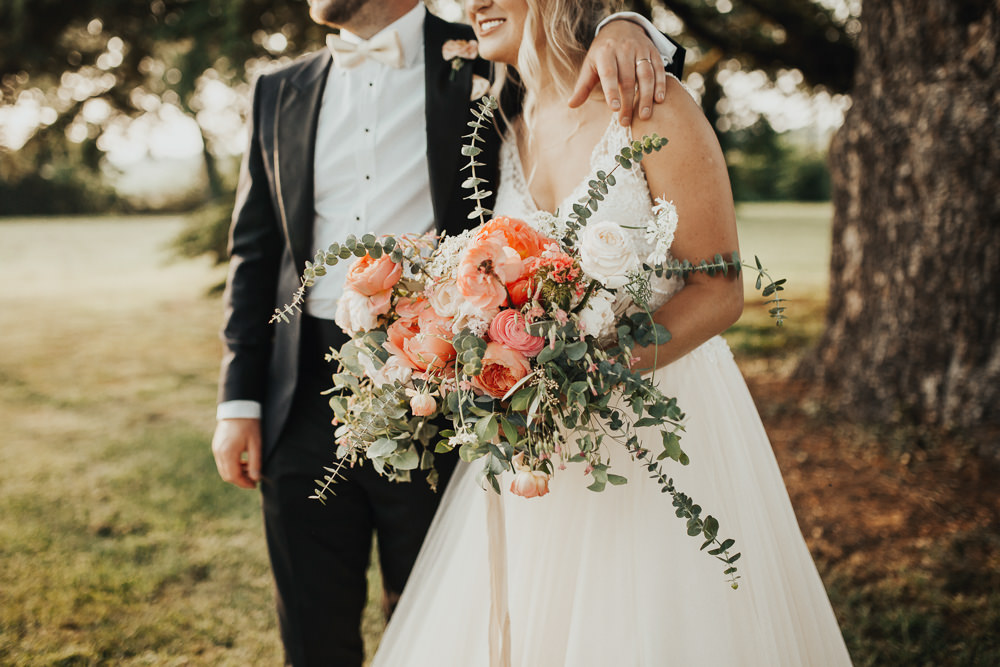 Bride Bridal Bouquet Flowers Coral Peony Peonies Rose Pink Ranunculus Eucalyptus Ribbon Stubton Hall Wedding Darina Stoda Photography
