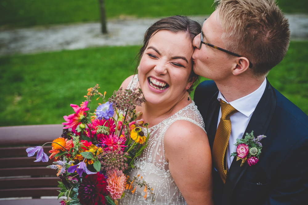 Bride Bridal Beaded Embellished Dress Navy Blue Tuxedo Mustard Tie Groom Multicoloured Bouquet Victoria Gallery Museum Wedding Emma Hillier Photography