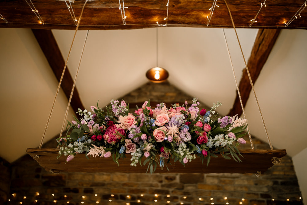 Suspended Hanging Swing Flowers Florals Pink Blue Pretty Blossom Barn Wedding Ideas Hayley Baxter Photography