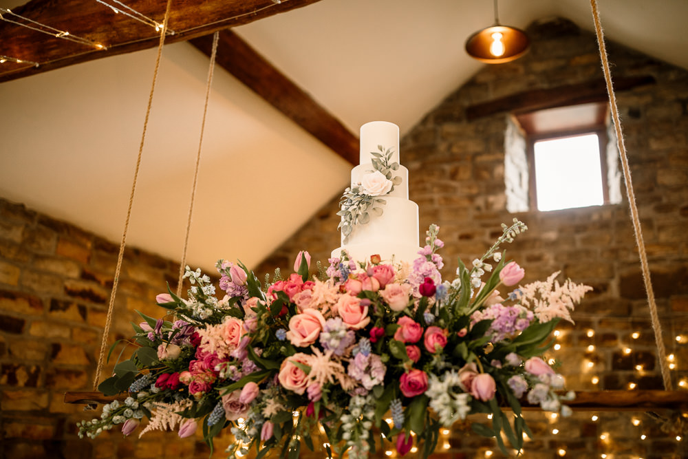 Suspended Hanging Swing Flowers Florals Pink Blue Pretty Cake Table Blossom Barn Wedding Ideas Hayley Baxter Photography