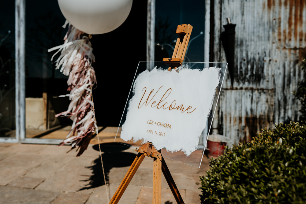 Welcome Sign Glass Easel Giant Balloon Tassel Calligraphy Contemporary Barn Wedding Ryan Goold Photography