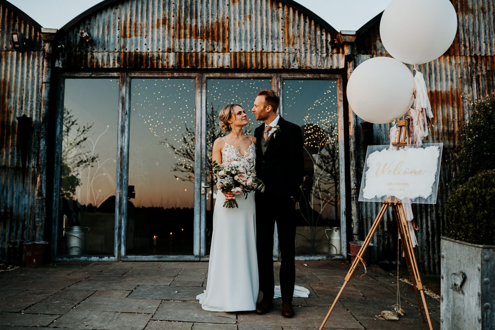 Bride Bridal Sleeveless Strappy Illusion Dress Silk Maxi Slim Separates Floral Tweed Waistcoat Groom Bouquet Welcome Sign Giant Balloons Tassels Tails Contemporary Barn Wedding Ryan Goold Photography