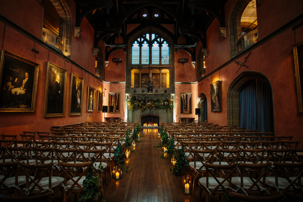 Ceremony Aisle Candles Pew End Fireplace Greenery Cowdray House Wedding Matt Sim Photography