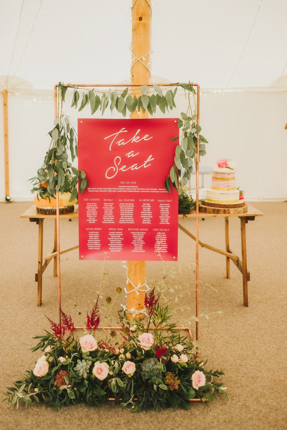 Seating Plan Table Chart Arch Backdrop Flowers Rose Astilbe Greenery Foliage Dorfold Hall Wedding Kate McCarthy Photography