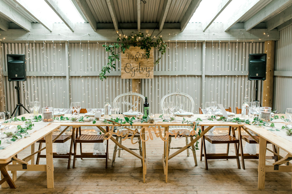 Mr & Mrs Wooden Sign Pea Light Curtain Greenery Tin Shed Knockraich Farm Wedding The Gibsons Photography